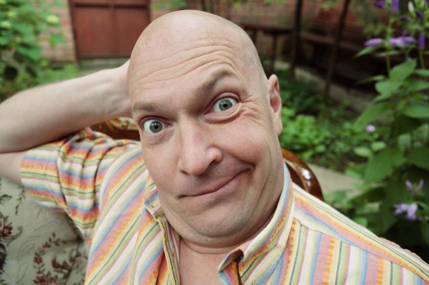 funny bald man in garden